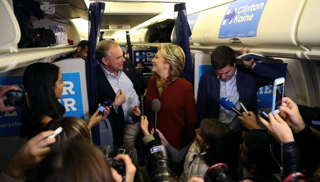 Former Secretary of State Hillary Clinton and her running mate, U.S. Sen. Tim Kaine, D-Va., answer questions aboard her plane at Pittsburgh International Airport on Oct. 22, 2016. (Getty Images)