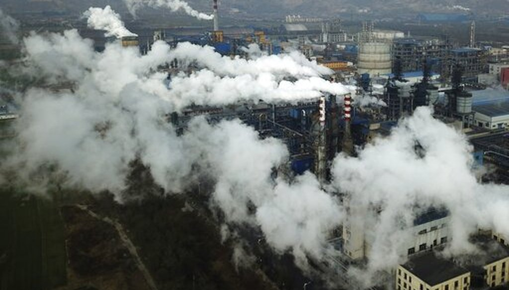 In this Nov. 28, 2019 file photo, smoke and steam rise from a coal processing plant in Hejin in central China's Shanxi Province. (AP)