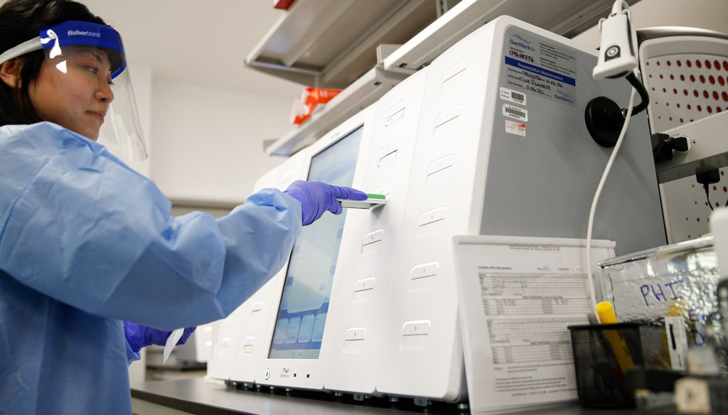 A laboratory technician prepares COVID-19 patient samples for semi-automatic testing at Northwell Health Labs, Wednesday, March 11, 2020 (AP photo/John Minchillo)