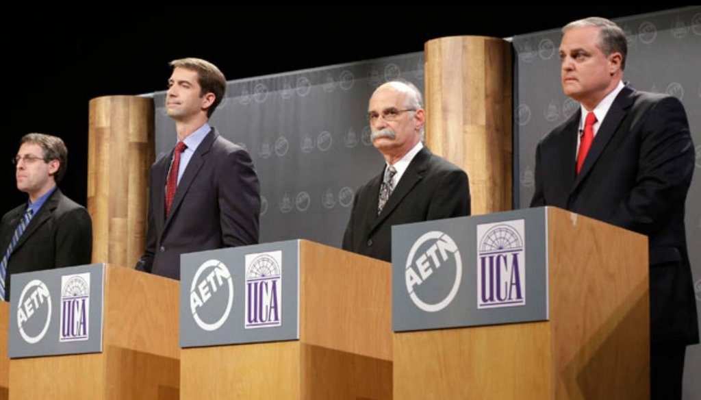 Rep. Tom Cotton (second from left) says Sen. Mark Pryor (far right) votes with Obama 93 percent of the time at an Oct. 13 debate.