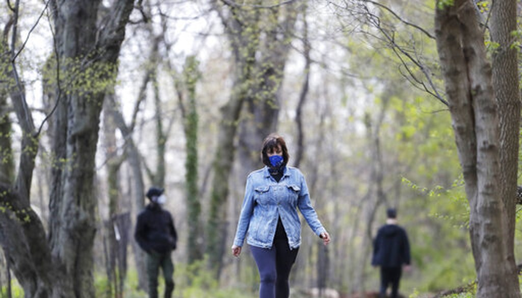 Alfina Schicker takes a solitary walk through the woods in Brooklyn's Prospect Park, Tuesday, April 14, 2020 during the coronavirus pandemic in New York. (AP)