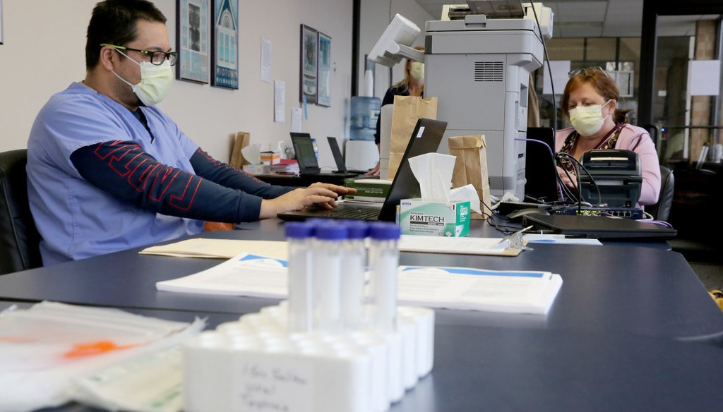 A nurse and assistant enter testing information at a COVID-19 drive through testing location in Milwaukee on Monday, April 27, 2020. (Photo by Mike De Sisti/Milwaukee Journal Sentinel)