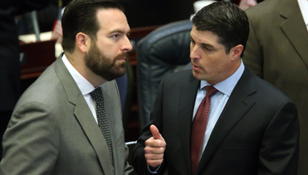 Speaker Steve Crisafulli, right, talks with Rep. Jose Diaz, R-Miami, on April 28, 2015, the same day Crisafulli adjourned the House early over a budget battle. (AP Photo)