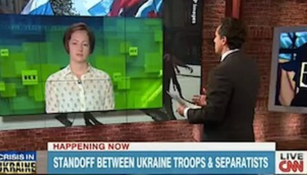 Correspondents from CNN and RT debate the situation in Ukraine.