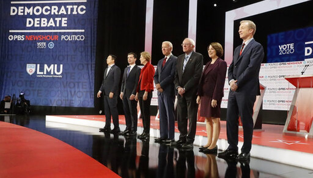 Democratic presidential candidates stand on stage before a Democratic presidential primary debate Thursday, Dec. 19, 2019, in Los Angeles, Calif. (AP)