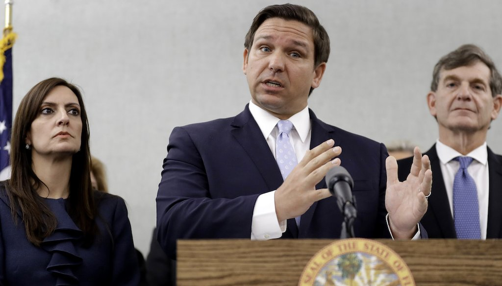 Florida Gov. Ron DeSantis, center, gestures as he stands with Lt. Gov. Jeanette Nunez, left, and State Surgeon General Dr. Scott Rivkees during a news conference March 2, 2020, in Tampa, Fla. (AP)