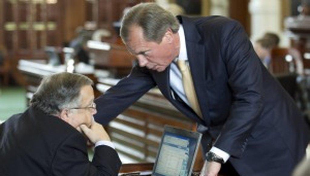 David Dewhurst talks to state Sen. John Carona in May (Austin American-Statesman photo by Jay Janner).