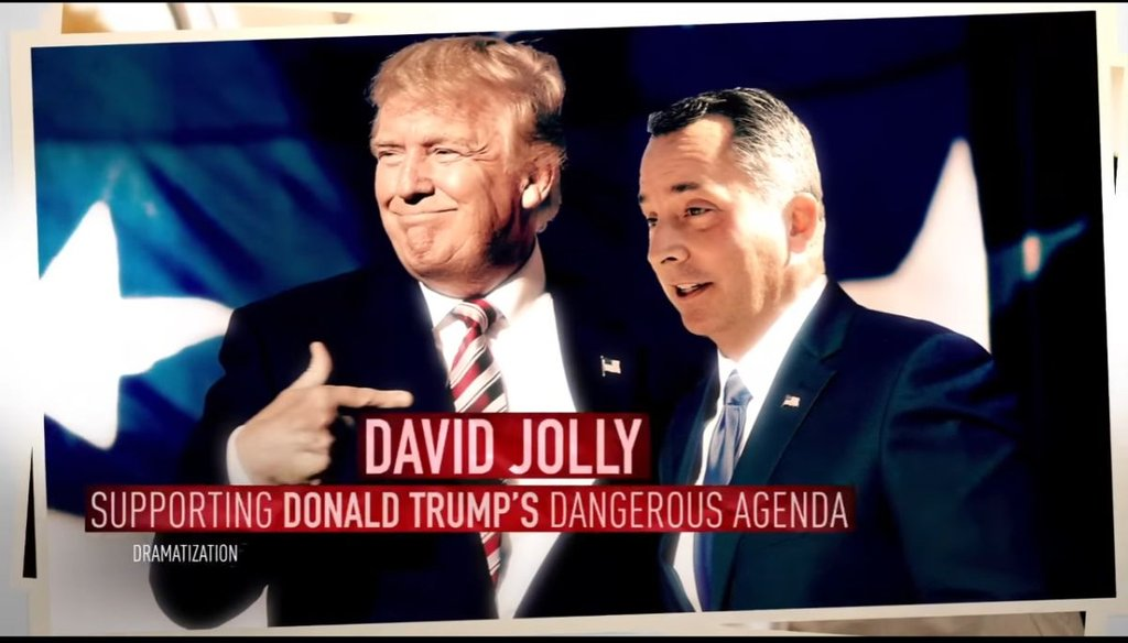 Donald Trump and David Jolly shake hands in this Photoshopped photo from the DCCC's ad.