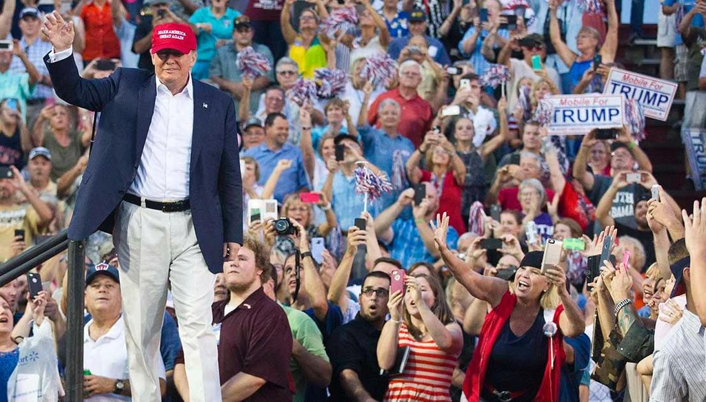 Republican presidential candidate Donald Trump waves to thousands of fans in Mobile, Ala., at an Aug. 22, 2015, campaign rally. Trump has said he would try to end birthright citizenship if elected. (AP photo)