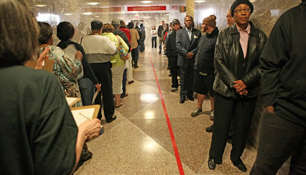 People line up for early voting in the 2012 presidential election. They waited at the Zeidler Municipal Building in Milwaukee. JS photo/Michael Sears