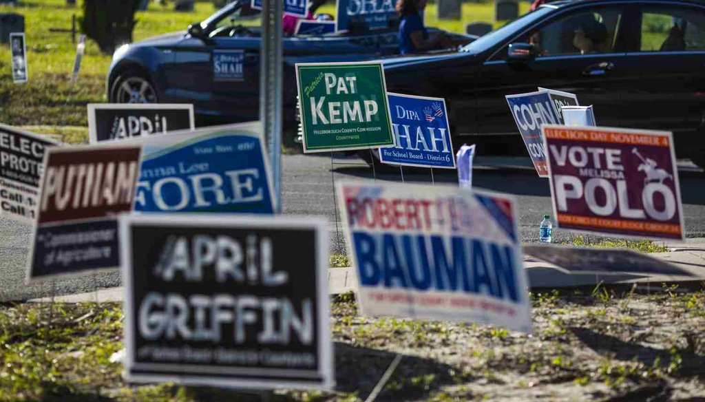 Signs outside a polling place in Tampa, Fla. (Tampa Bay Times photo)