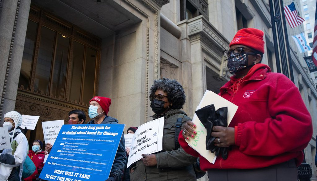 Members of the Grassroots Education Movement, which is comprised of parents of Chicago Public Schools students and community leaders, demanded Mayor Lori Lightfoot support an elected school board outside City Hall on March 3, 2021. | Pat Nabong/Sun-Times