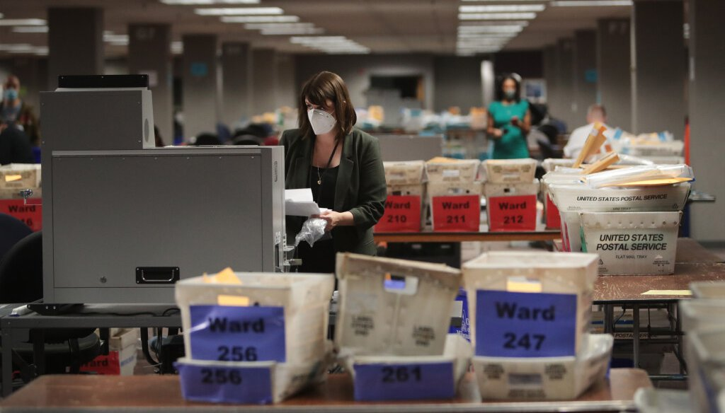 Claire Woodall-Vogg, executive director of the Milwaukee election commission collects the count from absentee ballots from a voting machine on November 04, 2020 in Milwaukee, Wisconsin.