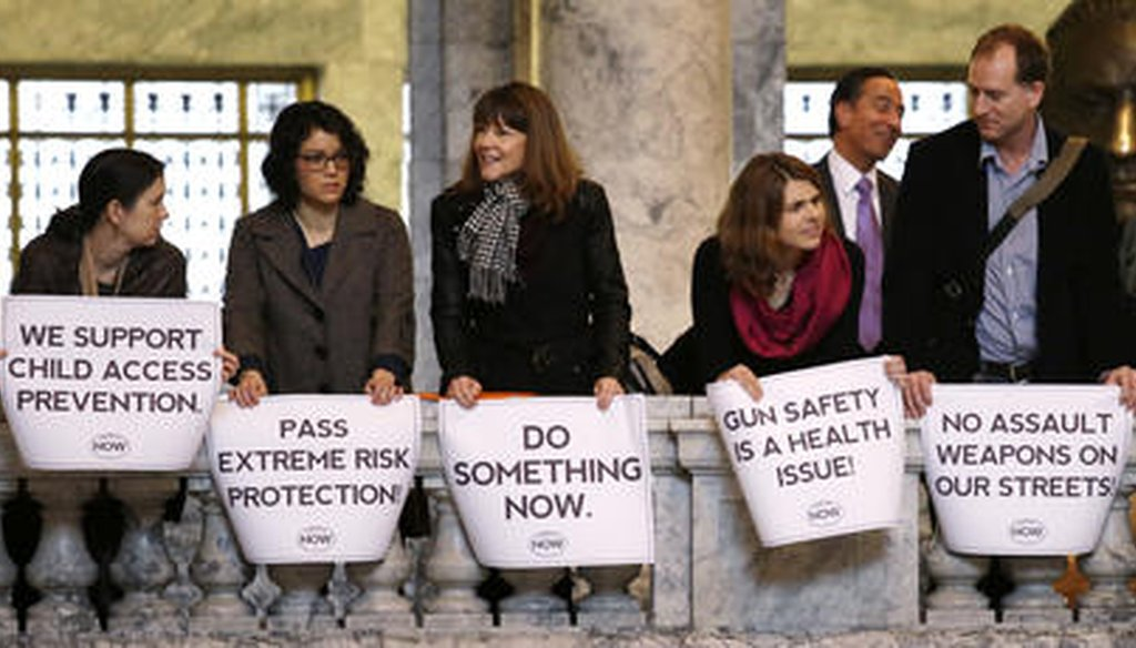 In this file photo taken Jan. 12, 2016, gun regulation activists stand with signs in the Washington state Capitol rotunda. State voters passed an initiative to create extreme risk protection orders. (AP)