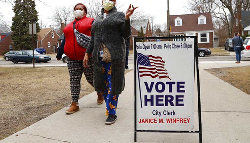 Voters arrive with masks in light of the coronavirus COVID-19 health concern at Warren E. Bow Elementary School in Detroit, Tuesday, March 10, 2020. (AP)