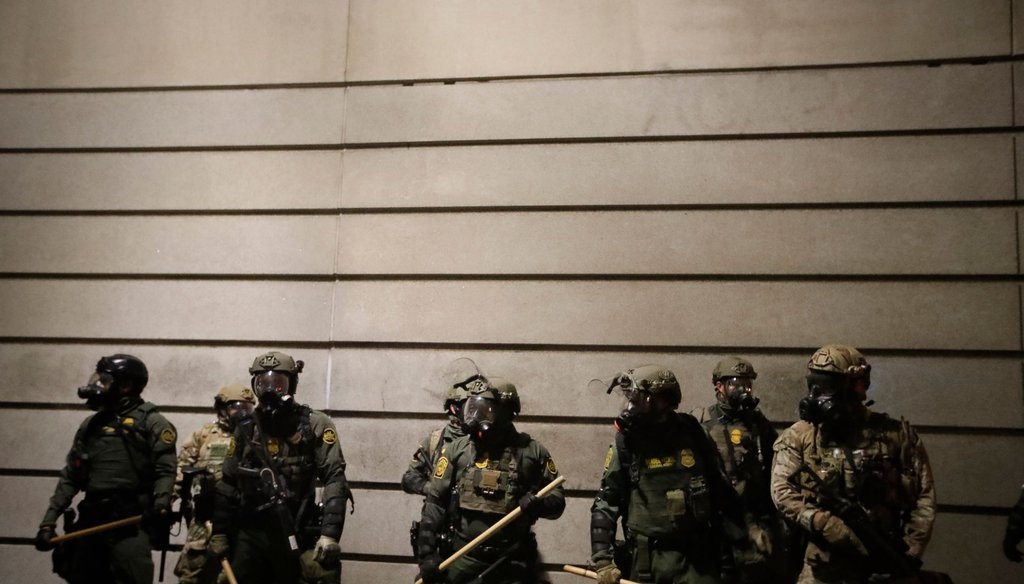 Federal agents watch demonstrators after an illegal assembly was declared during a Black Lives Matter protest at the Mark O. Hatfield United States Courthouse on July 29, 2020, in Portland, Ore. (AP)