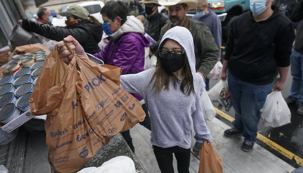 Food donations are brought to a collection site during the Feed Utah food drive Saturday, March 20, 2021, in Sandy, Utah. (AP)
