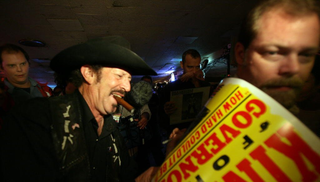 During his 2006 run for governor, singer and humorist Kinky Friedman signs campaign posters at the Broken Spoke dance hall in Austin. (Laura Skelding photo/2006 Austin American-Statesman)