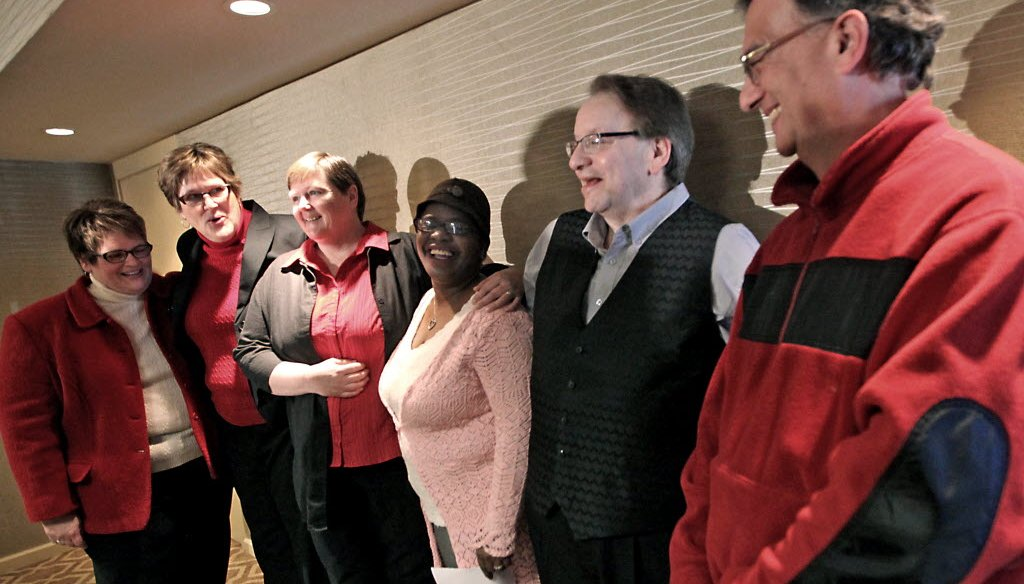 Plaintiffs in a federal lawsuit challenging Wisconsin's ban on gay marriage appear during a press conference at the Concourse Hotel in Madison, Feb. 3, 2014. AP