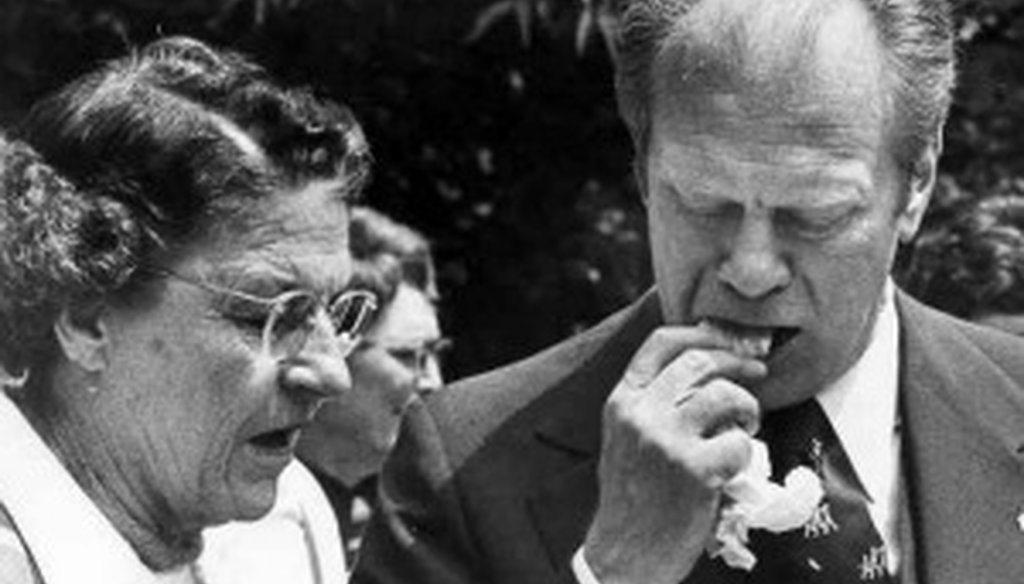 President Gerald Ford bites into a tamale after a tour of the Alamo on April 10, 1976.