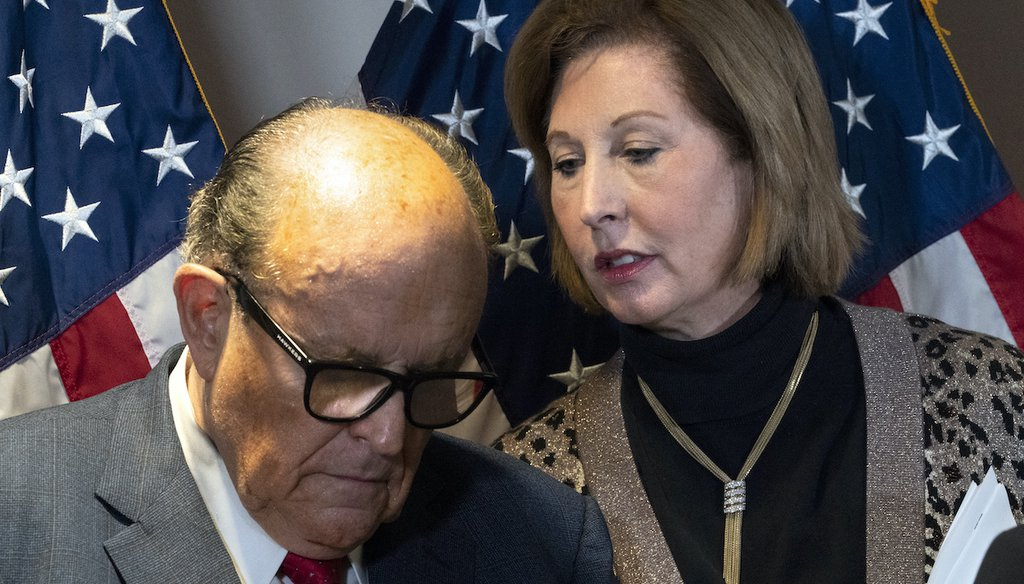 Former New York Mayor Rudy Giuliani, left, and Sidney Powell, both lawyers for then-President Donald Trump, during a news conference Nov. 19, 2020, in Washington. (AP)