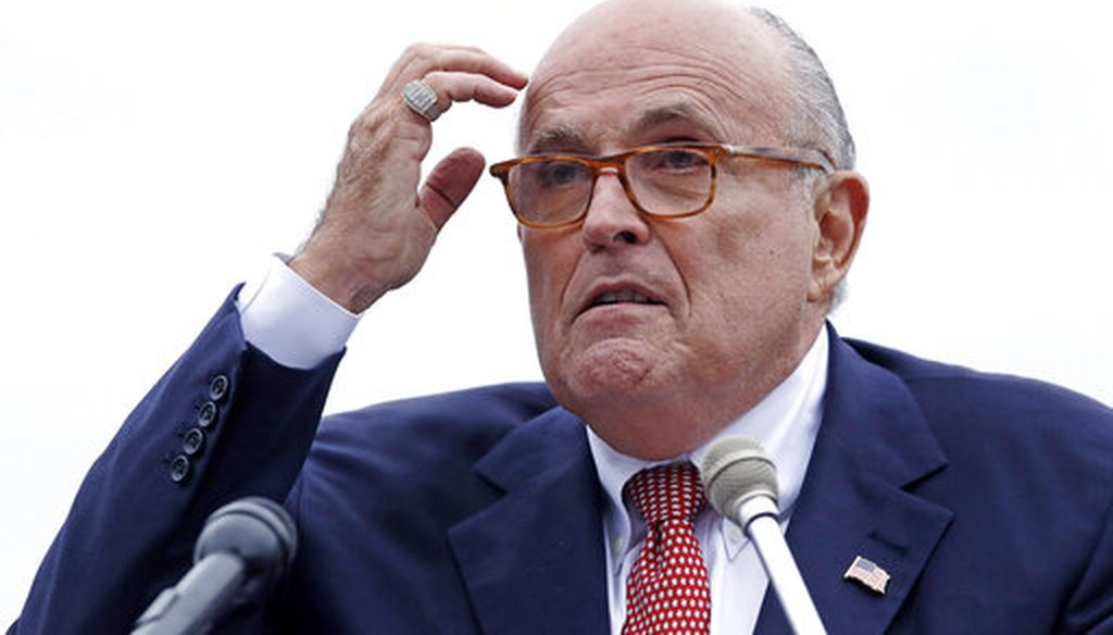Rudy Giuliani addresses a gathering during a campaign event for Eddie Edwards in Portsmouth, N.H. on Aug. 1, 2018. (AP/Krupa)
