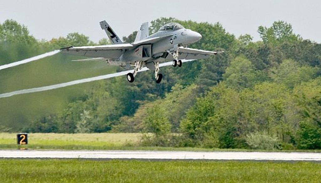 "Navy aviators conduct a test flight of the supersonic ""Green Hornet,"" an F/A-18 Super Hornet strike fighter jet powered by a 50/50 biofuel blend on April 22, 2010. (U.S. Navy)"