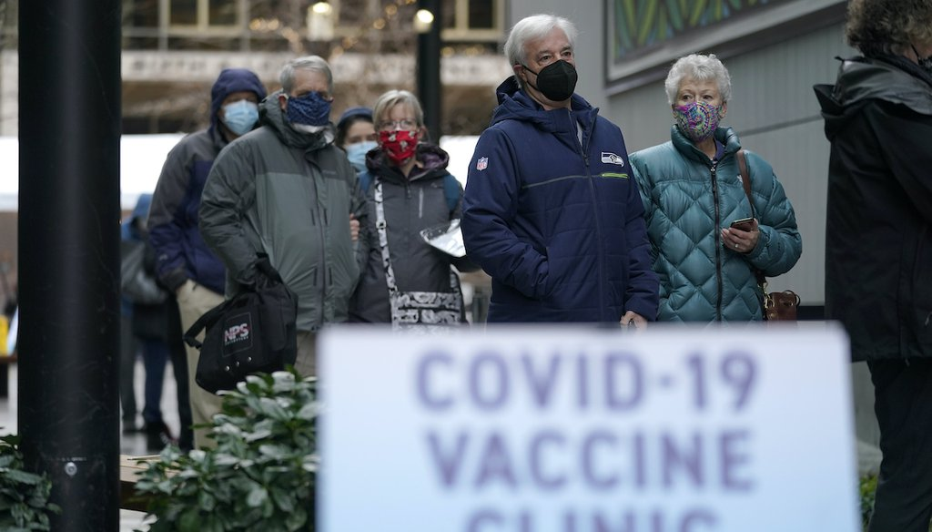 People wait in line to receive the first of two doses of the Pfizer vaccine for COVID-19, Sunday, Jan. 24, 2021, at a one-day vaccination clinic set up in an Amazon.com facility in Seattle and operated by Virginia Mason Franciscan Health. (AP)