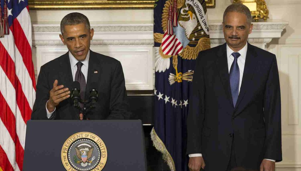 President Barack Obama stands with Attorney General Eric H. Holder Jr. who announced his resignation. (Getty)