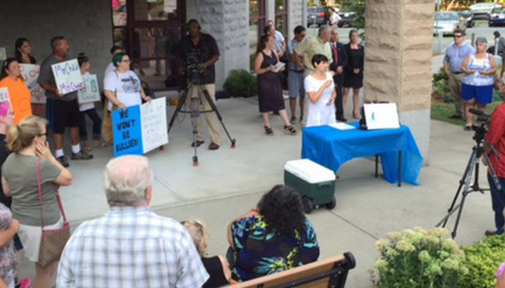 Critics rally against the HPV vaccination policy at the Cumberland Public Library.