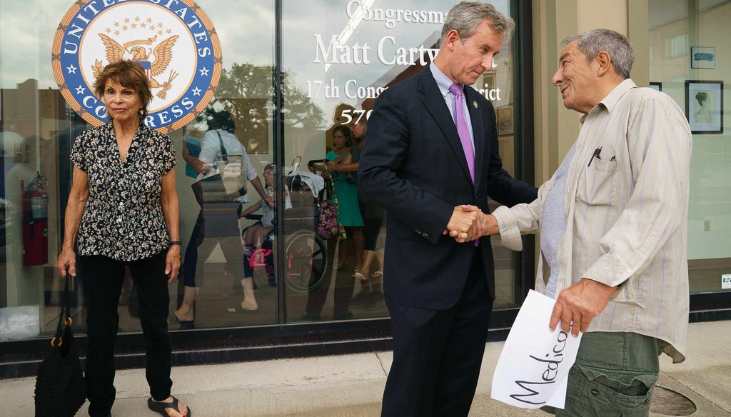U.S. Rep. Matt Cartwright shakes hands with Michael Precone (right) after a meeting with medicare and medicaid recipients in Scranton Tuesday, July 31, 2018.