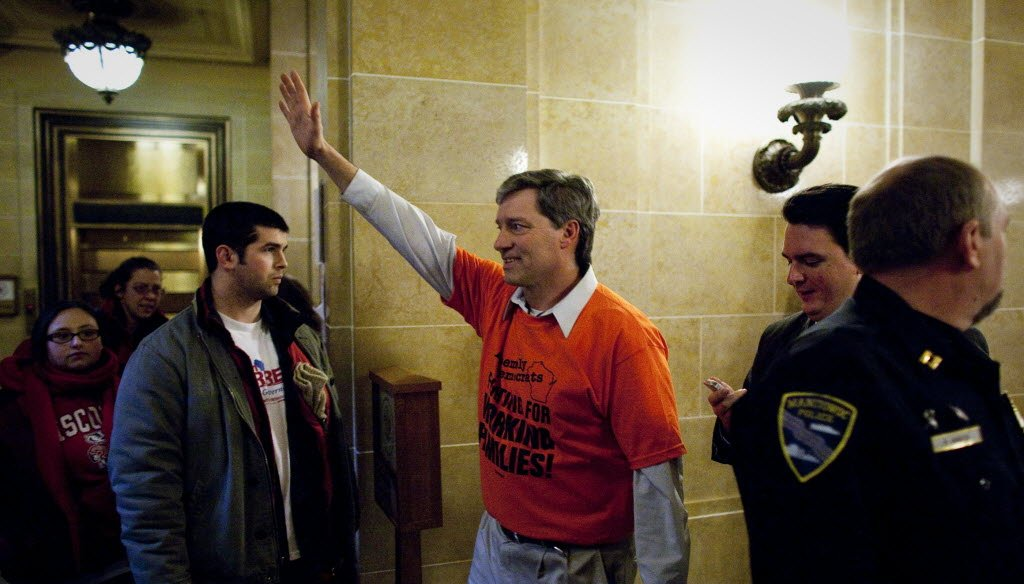 Wisconsin Assembly Democrat Brett Hulsey waves to supporters after he crashed Governor Scott Walker's press conference at the Capitol in Madison on February 23, 2011. JS photo