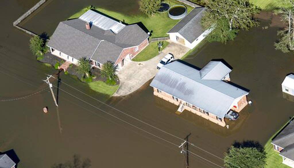 Houses surrounded by flood waters are seen in the aftermath of Hurricane Delta Saturday Oct. 10, 2020, in Welsh, La. (AP)