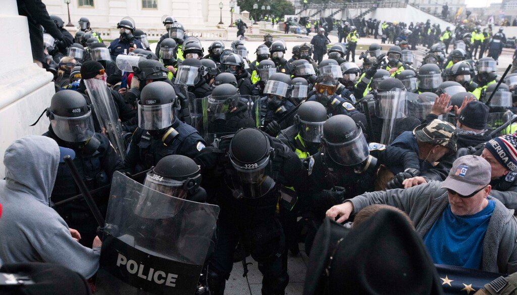 In this Jan. 6, 2021, file photo, U.S. Capitol Police push back rioters trying to enter the U.S. Capitol in Washington.