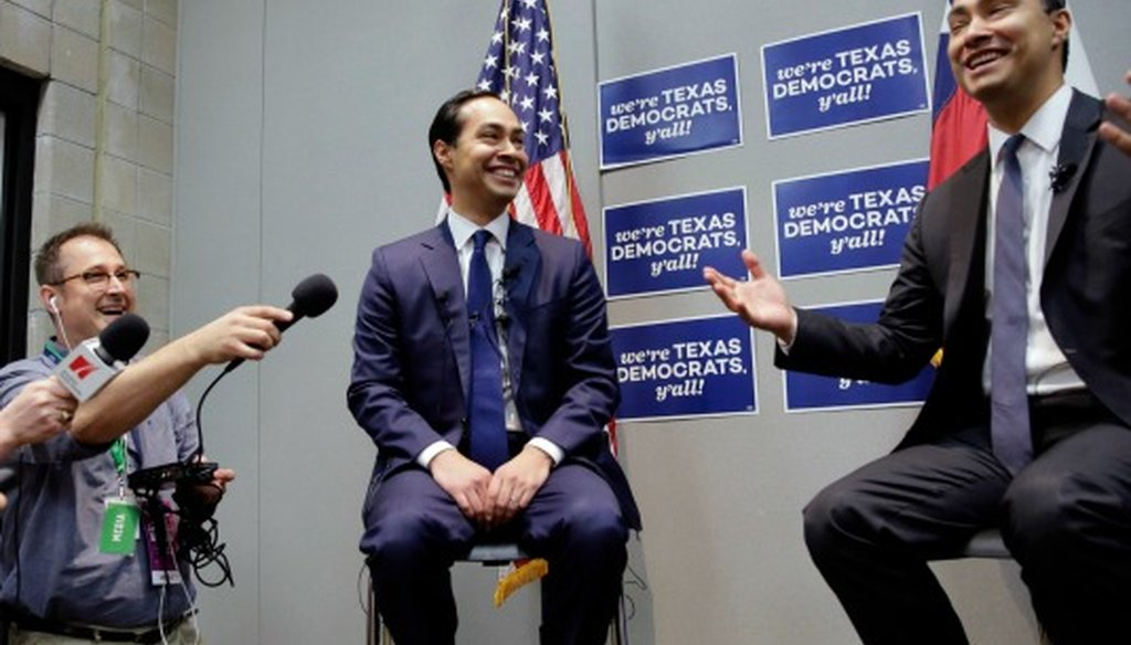 Housing and Urban Development Secretary Julian Castro, left, smiles with his brother during the Texas Democratic Party convention where the secretary made claims comparing the California and Texas economies (Associated Press photo, Eric Gay).