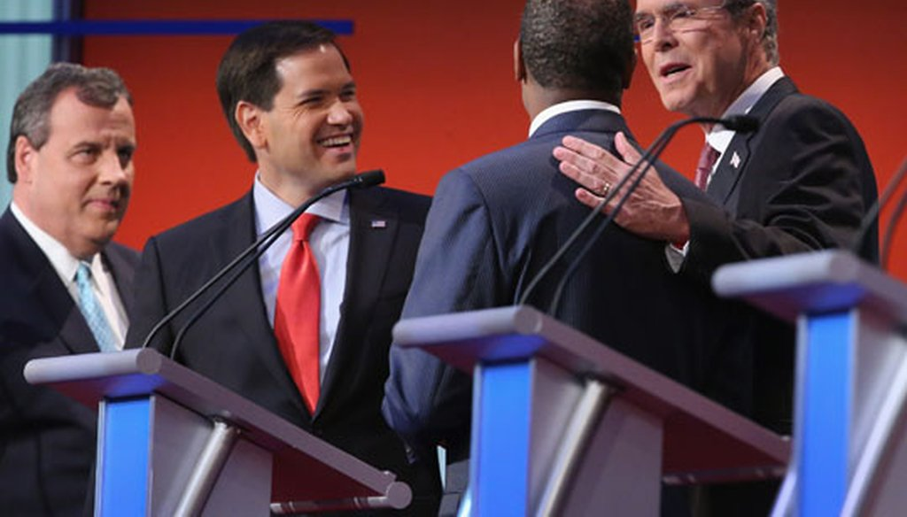 Republican presidential candidates N.J. Gov. Chris Christie, Florida Sen. Marco Rubio, Ben Carson and former Gov. Jeb Bush visit during a break at the first GOP debate in Cleveland on Aug. 6, 2015. (Getty Images)