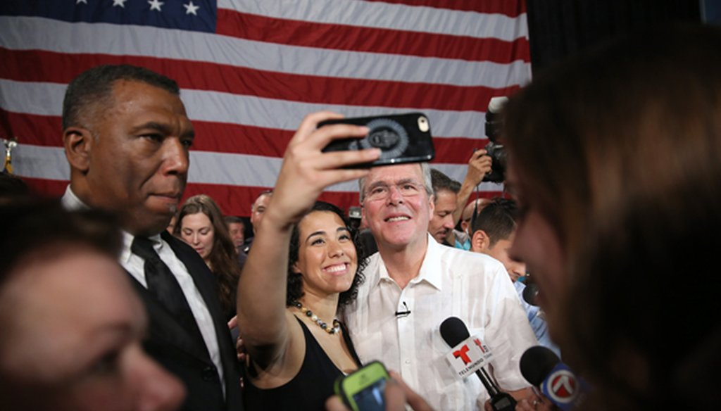 Former Gov. Jeb Bush takes a photo with a supporter at a fund-raiser in Sweetwater on May 18, 2015. (Getty Images)