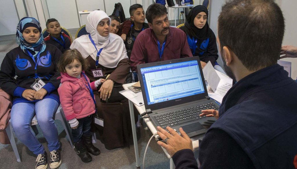 A family of Syrian refugees are interviewed by authorities in hope of being approved for passage to Canada at a refugee processing center in Amman, Jordan, Nov. 29, 2015. (Paul Chiasson/The Canadian Press via AP)