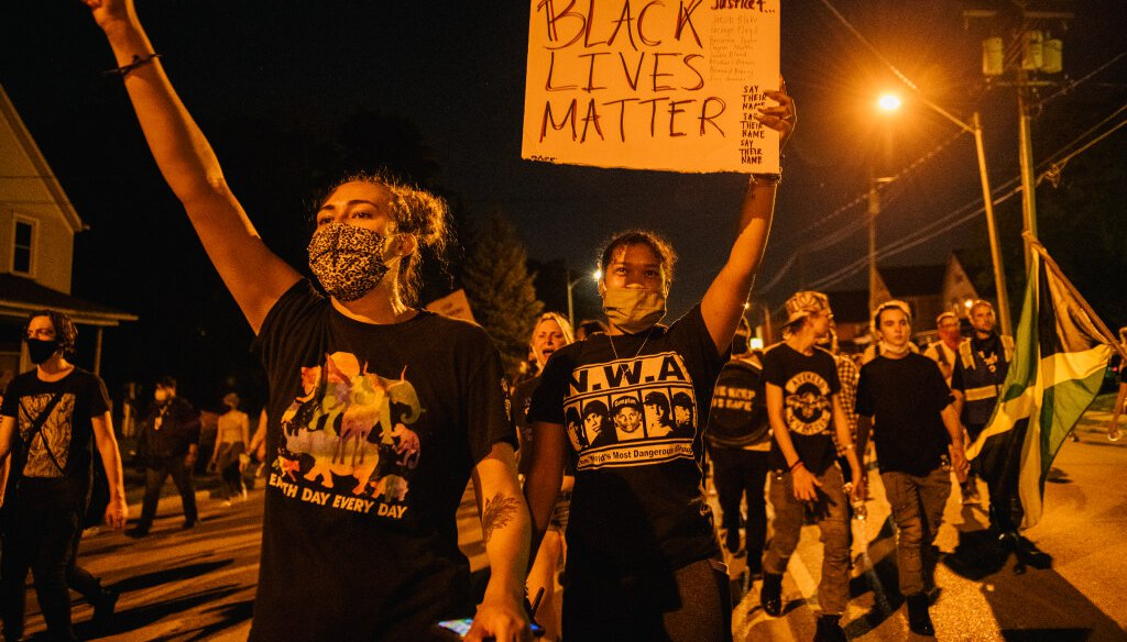 Demonstrators chant in a march on August 26, 2020 in Kenosha, after a fourth night of civil unrest occurred following the shooting of Jacob Blake.   (Photo by Brandon Bell/Getty Images)