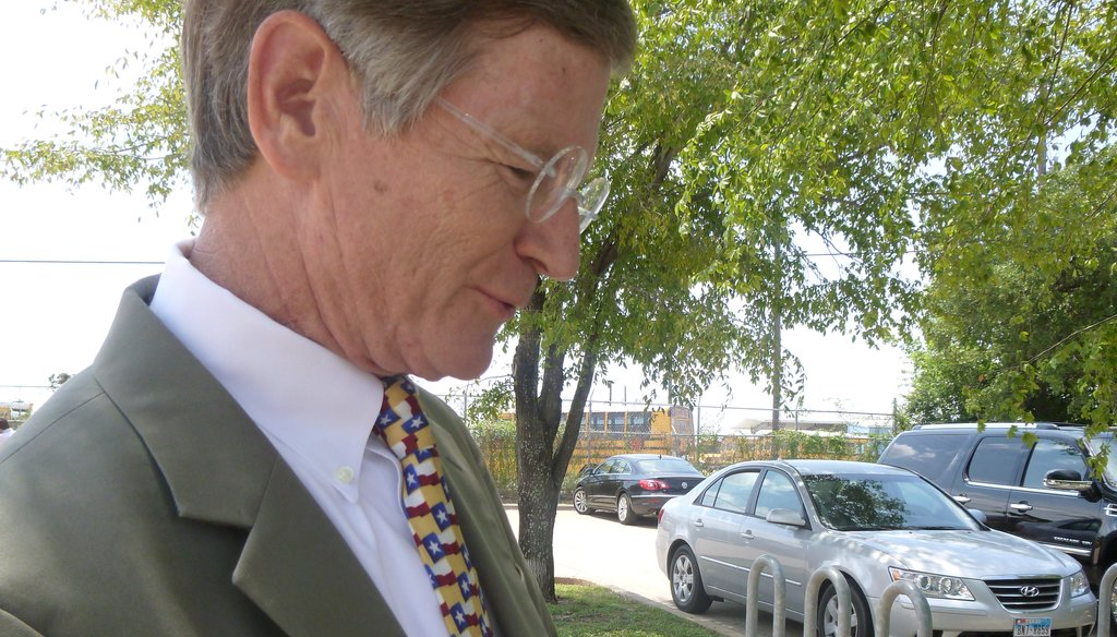 Outside a South Austin restaurant, U.S. Rep. Lamar Smith, R-San Antonio, shows the tax chart he keeps in his wallet with figures he had just used in speaking to the Austin-Oak Hill Rotary Club on Aug. 23, 2012. (Sue Owen photo/Austin American-Statesman)
