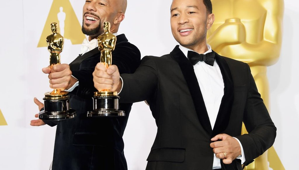 Common (left) and John Legend, winners of the Best Original Song Award for 'Glory' from 'Selma,' pose in the press room during the 87th Annual Academy Awards at Loews Hollywood Hotel on Feb. 22, 2015. (Getty)