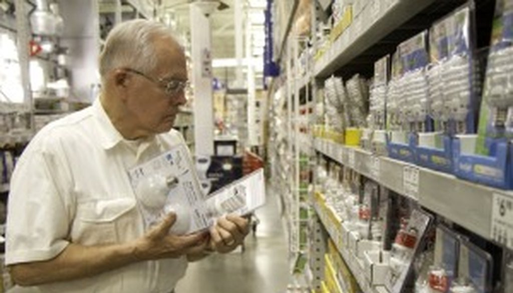 Richard Anderson browses the light bulb selection at a Lowe's in Greenville, S.C.