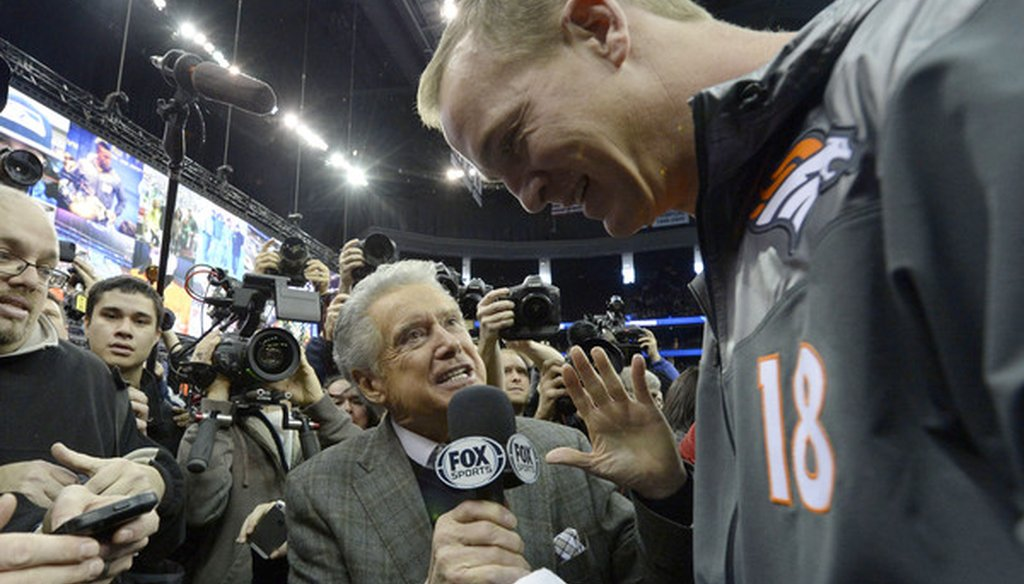 Fox Sports 1 host Regis Philbin interviews Denver Broncos quarterback Peyton Manning.