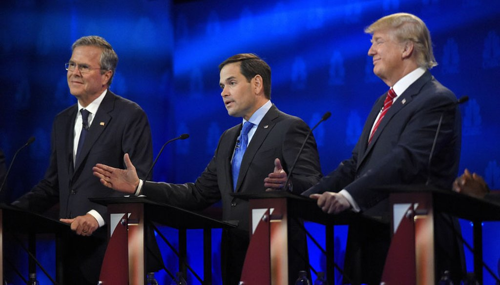 U.S. Sen. Marco Rubio, between Jeb Bush and Donald Trump, speaks at the Republican presidential debate in Boulder, Colo., on Oct. 28, 2015. (AP photo)