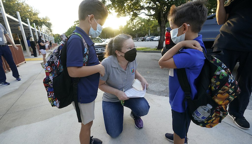 Juliana Orosi checks in students on the first day of class at Fox Trail Elementary School, Friday, Oct. 9, 2020, in Davie, Fla. (AP)
