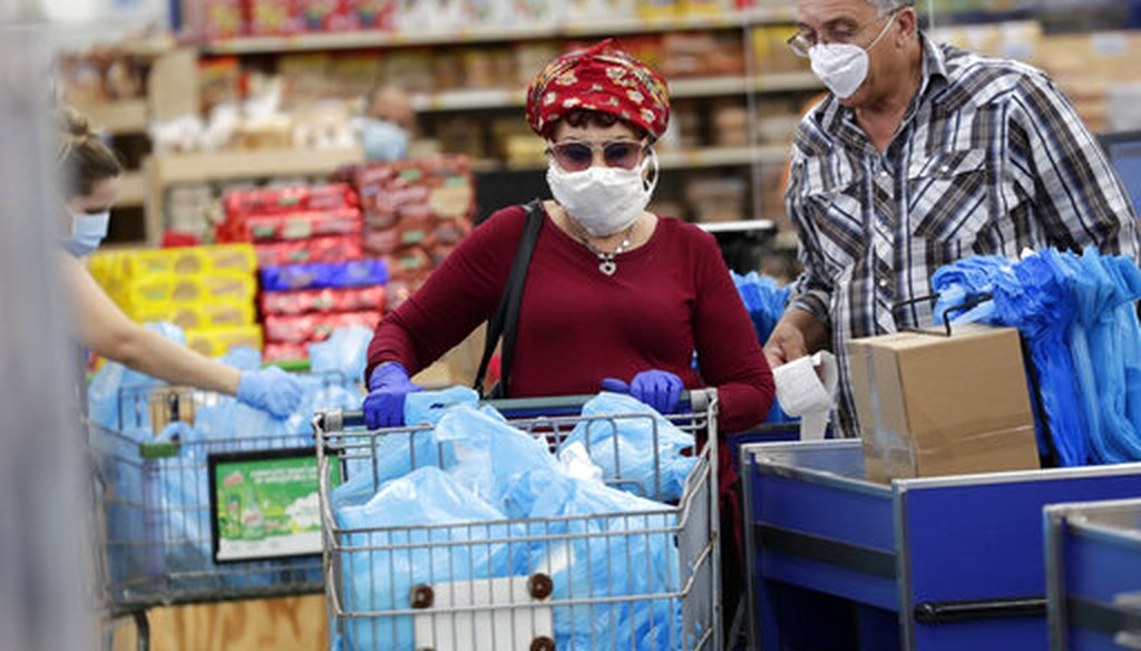 Customers wear protective masks while shopping at the Presidente Supermarket April 21, 2020, in Hialeah, Fla. (AP)
