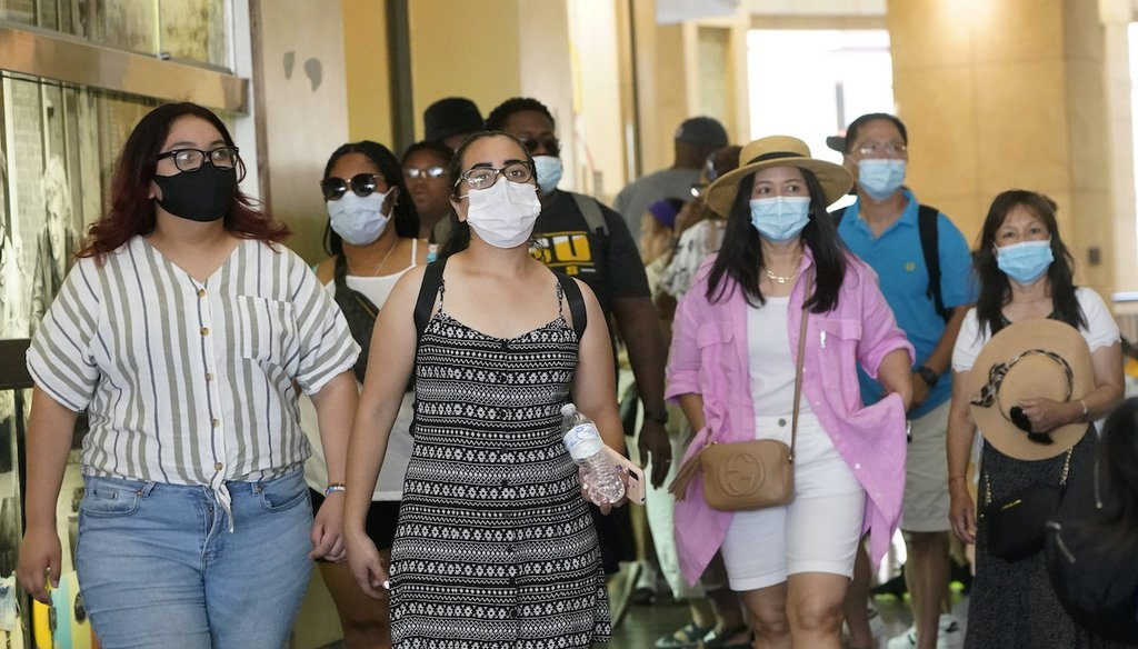 Visitors wear masks as they walk in a shopping district Thursday, July 1, 2021, in the Hollywood section of Los Angeles. (AP)