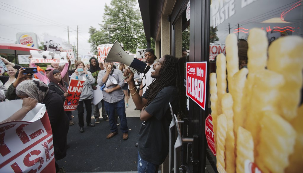 Fast food workers plan to strike again Sept. 4, 2014, over McDonald's wages. Critics point to better treatment among McDonald's workers in Denmark. (AP)