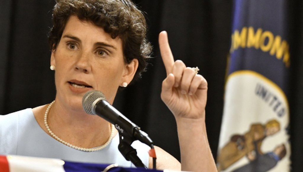 Amy McGrath, a Kentucky Democratic candidate for Congress, speaks to supporters during the 26th Annual Wendell Ford Dinner, Saturday, Aug. 18, 2018, in Louisville, Ky. (AP Photo/Timothy D. Easley)