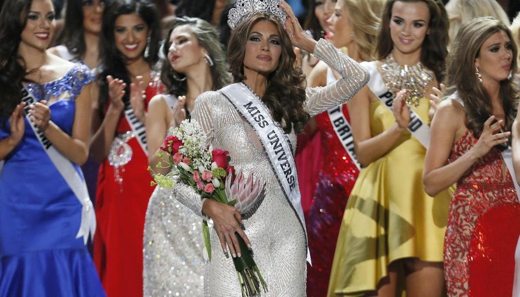 Miss Universe 2013 Gabriela Isler, from Venezuela, adjusts her crown after winning the pageant in Moscow, Russia, on Nov. 9, 2013. (AP)